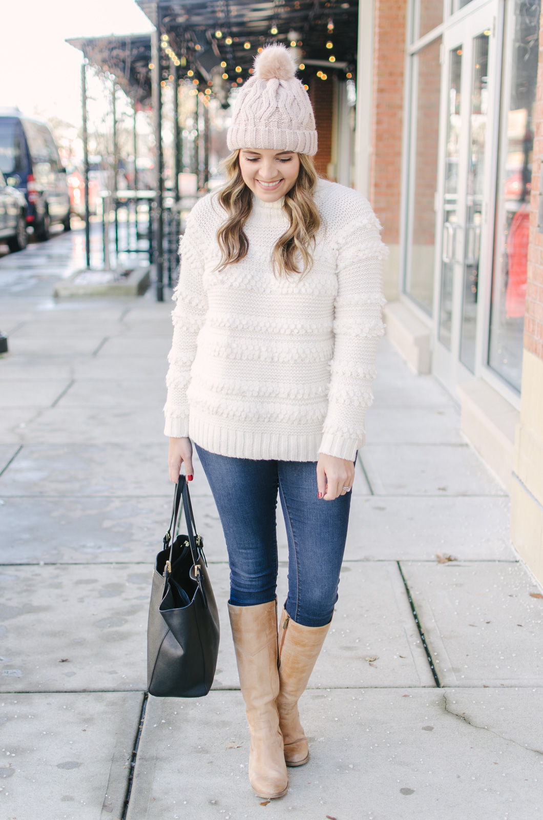 cream oversized sweater and a beanie outfit - I am obsessed with this textured sweater! | Get all the outfit details and see more cute Winter outfits at bylaurenm.com!