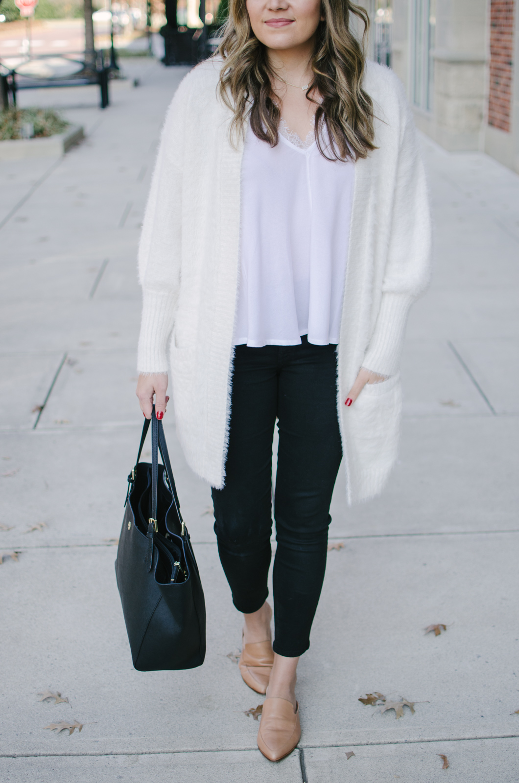 casual winter white outfit - I'm in love with this cozy cardigan and lacy tank | Get outfit details or see more cute casual Winter outfits at bylaurenm.com