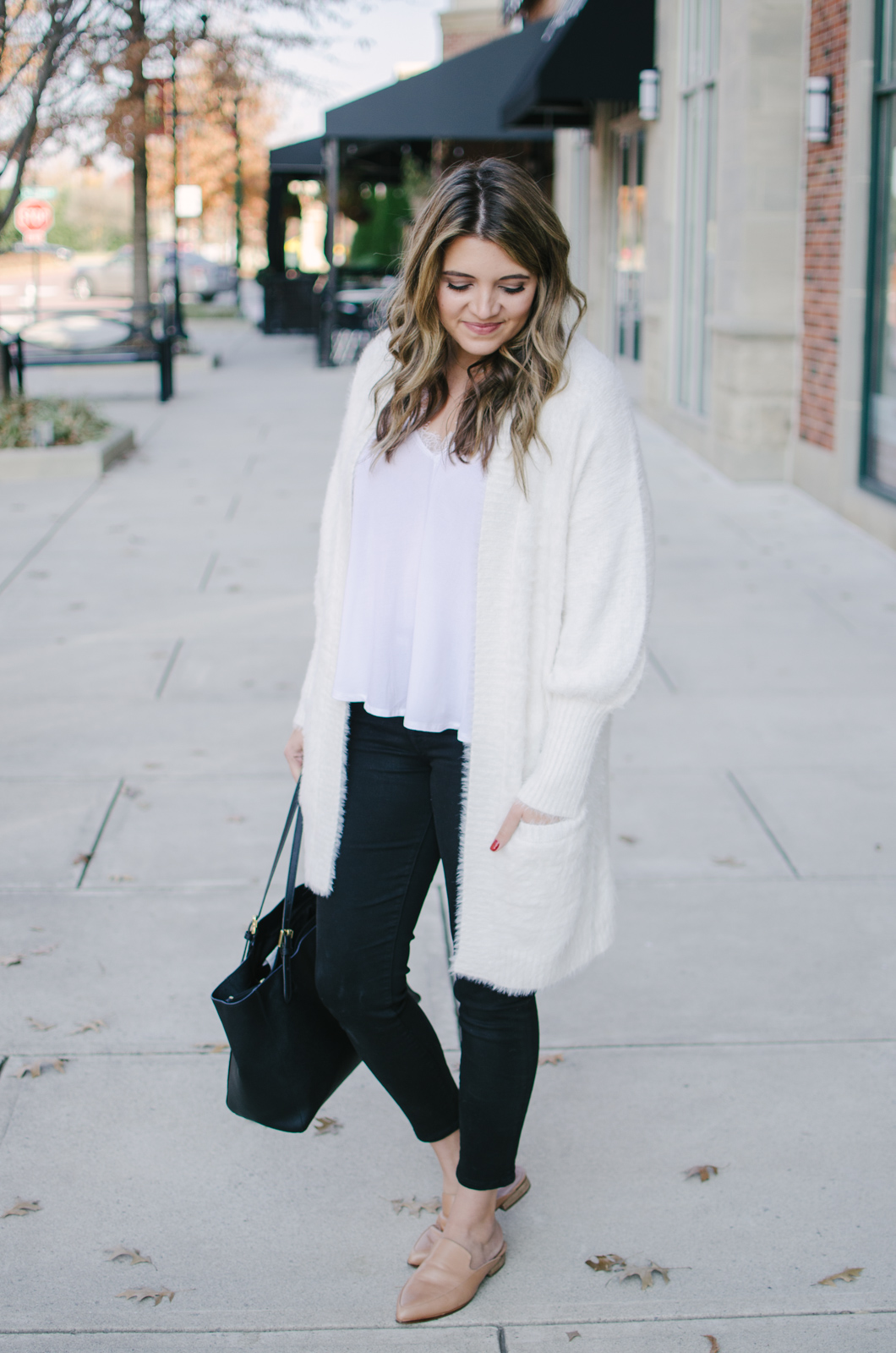winter white outfit - I love this cozy fuzzy cardigan! And it's under $35! | Get outfit details or see more cute casual Winter outfits at bylaurenm.com