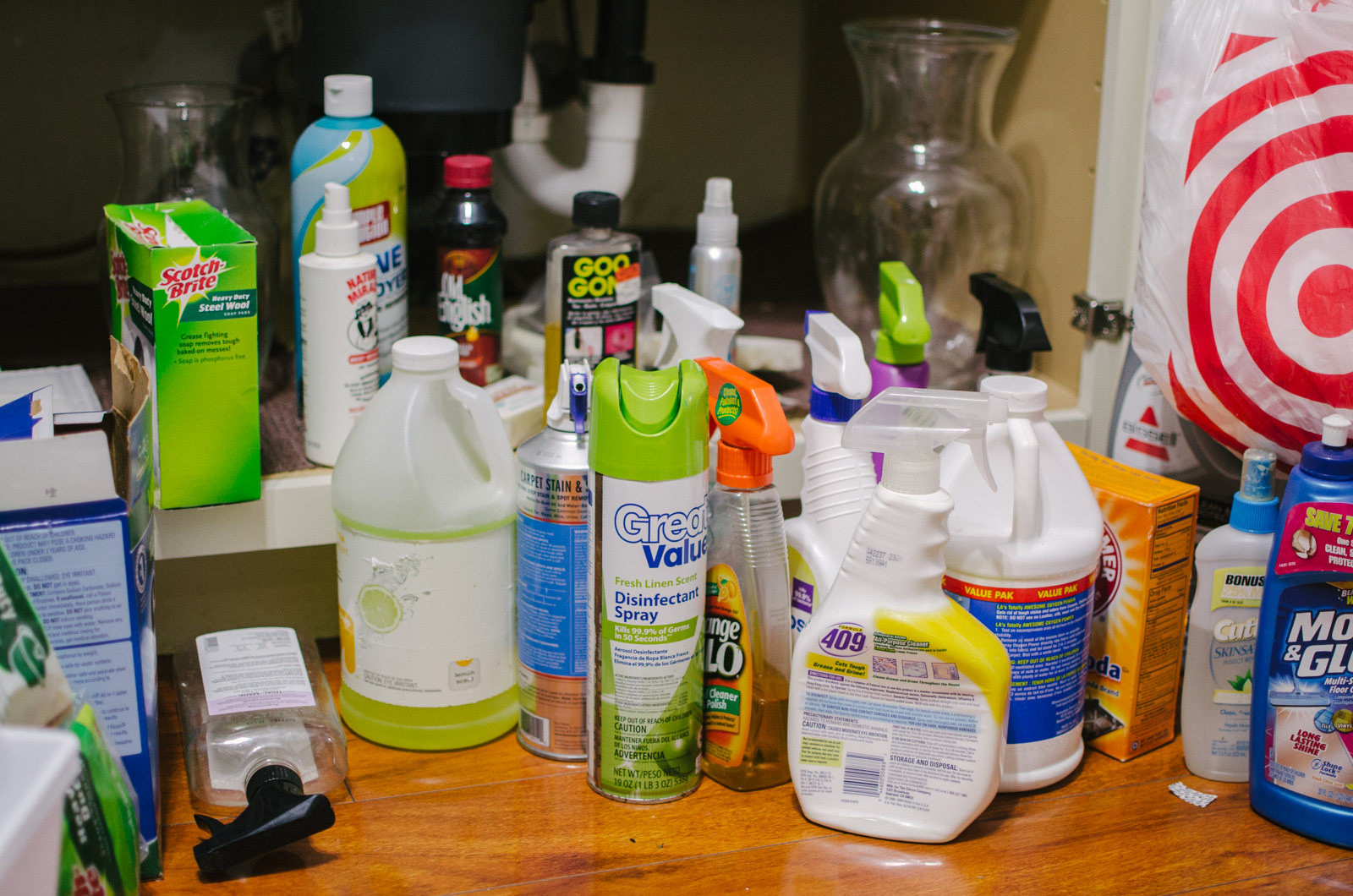 how to organize under the kitchen sink - dollar store organization hacks | You're going to love this kitchen organization before and after! Spend $5 and completely revamp your under sink cabinets! | bylaurenm.com