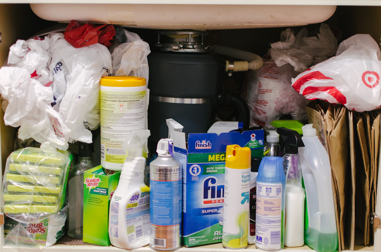 under the sink cabinet organization - how to organize under the kitchen sink. Come see how this messy before was transformed for only $5! | bylaurenm.com