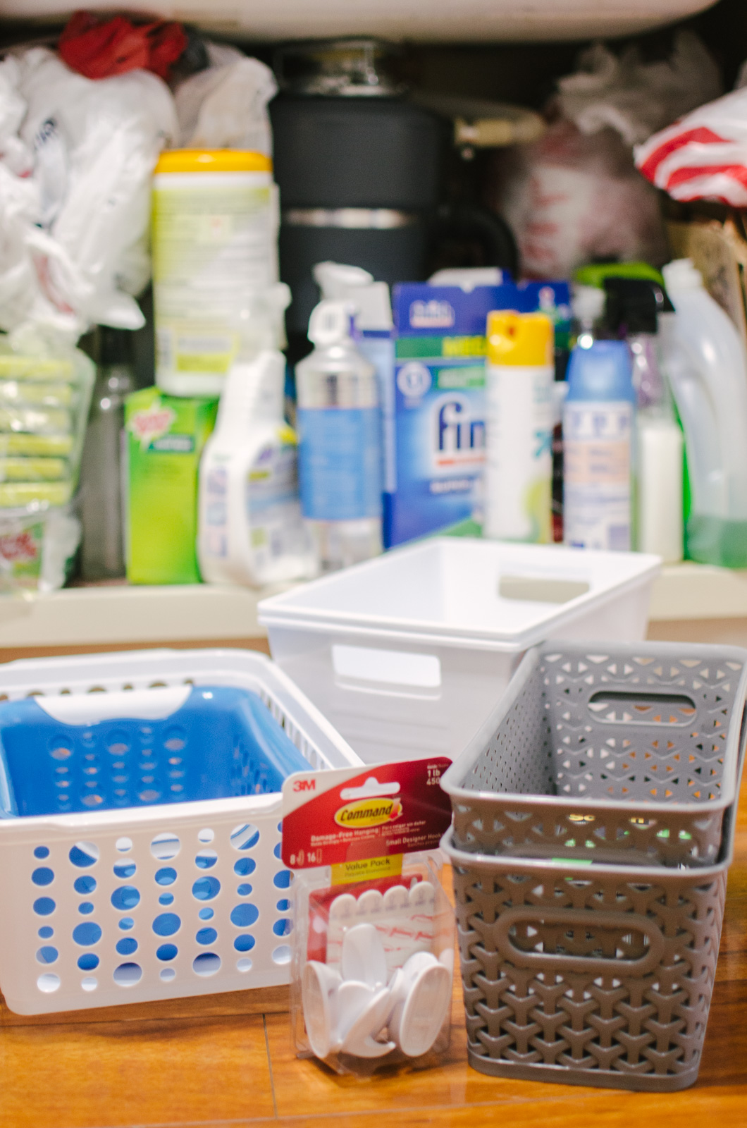 under the sink organization dollar store - You're going to love this kitchen organization before and after! Spend $5 and completely revamp your under sink cabinets! | bylaurenm.com