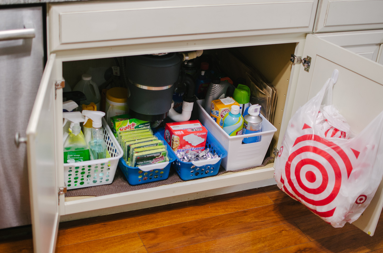 under the sink kitchen organization - You're going to love this kitchen organization before and after! Spend $5 and completely revamp your under sink cabinets! | bylaurenm.com