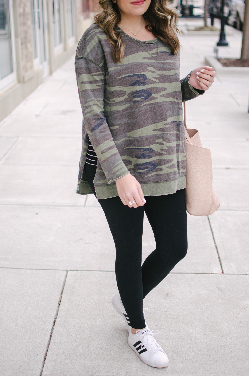 my current fav winter leggings outfit - I love this mix of camo and stripes | Get all the outfit details or see more cute leggings outfits at bylaurenm.com!