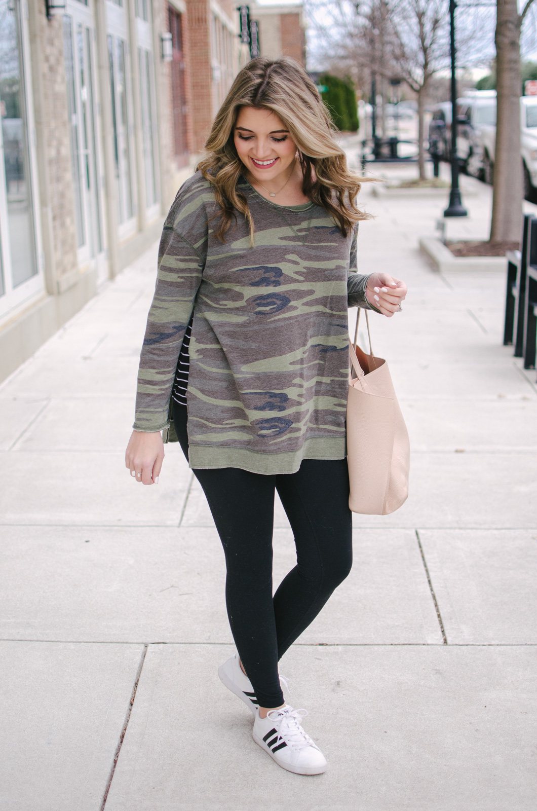 my current fav winter leggings outfit - I can't quit wearing this camo pullover! | Get all the outfit details or see more cute leggings outfits at bylaurenm.com!
