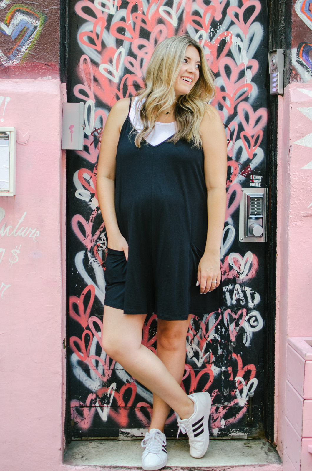 maternity romper with a tank top - cute summer pregnancy casual outfit | This adorable maternity romper is only $24 and also comes in a non-maternity version! Come read all the ways to wear it at bylaurenm.com!