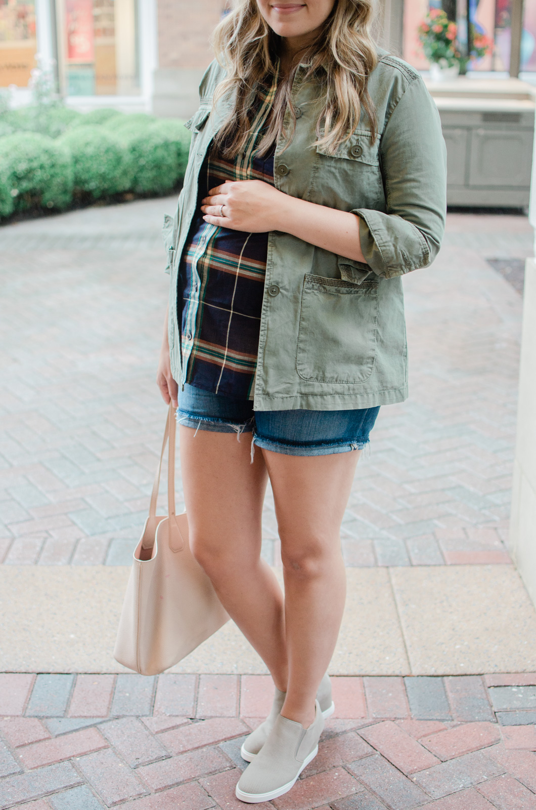early fall maternity style - the perfect fall transition bump outfit - plaid button down with utility jacket, shorts, and wedge sneakers | bylaurenm.com