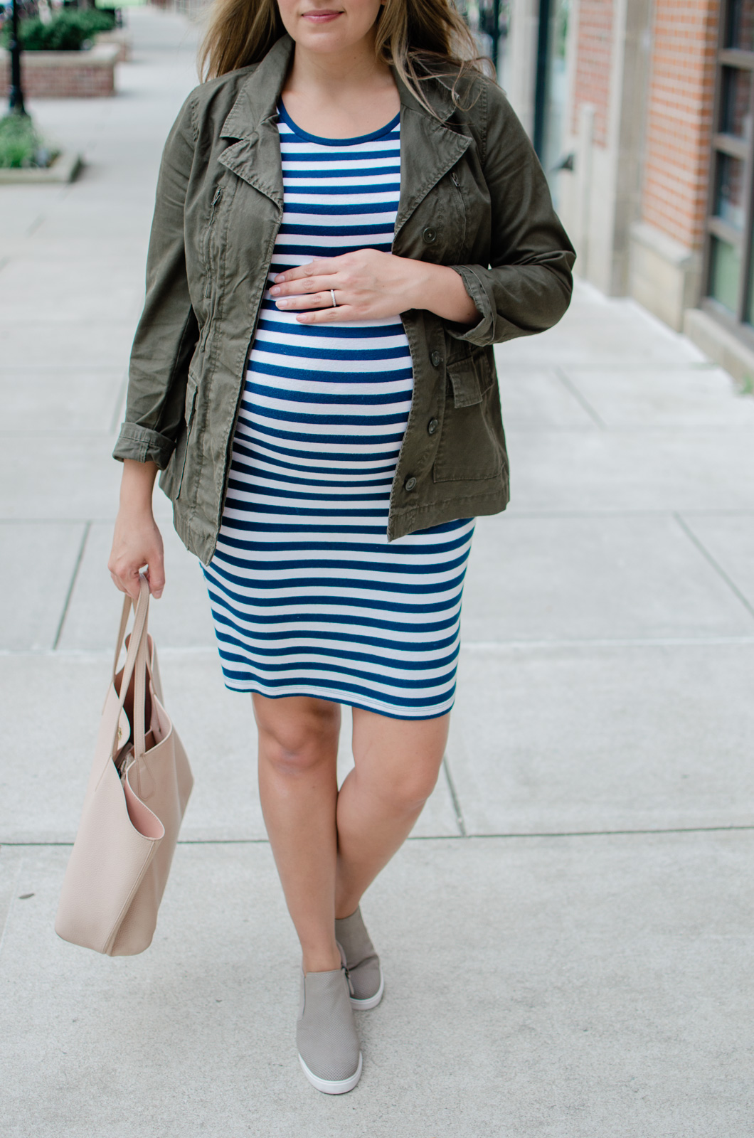casual maternity style - a favorite fall outfit idea with cargo jacket and stripe dress | bylaurenm.com