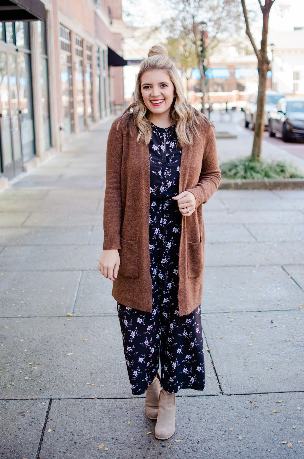 four jumpsuit outfits - jumpsuit with booties and a cardigan. Head to bylaurenm.com to see the other three ways to wear a jumpsuit!