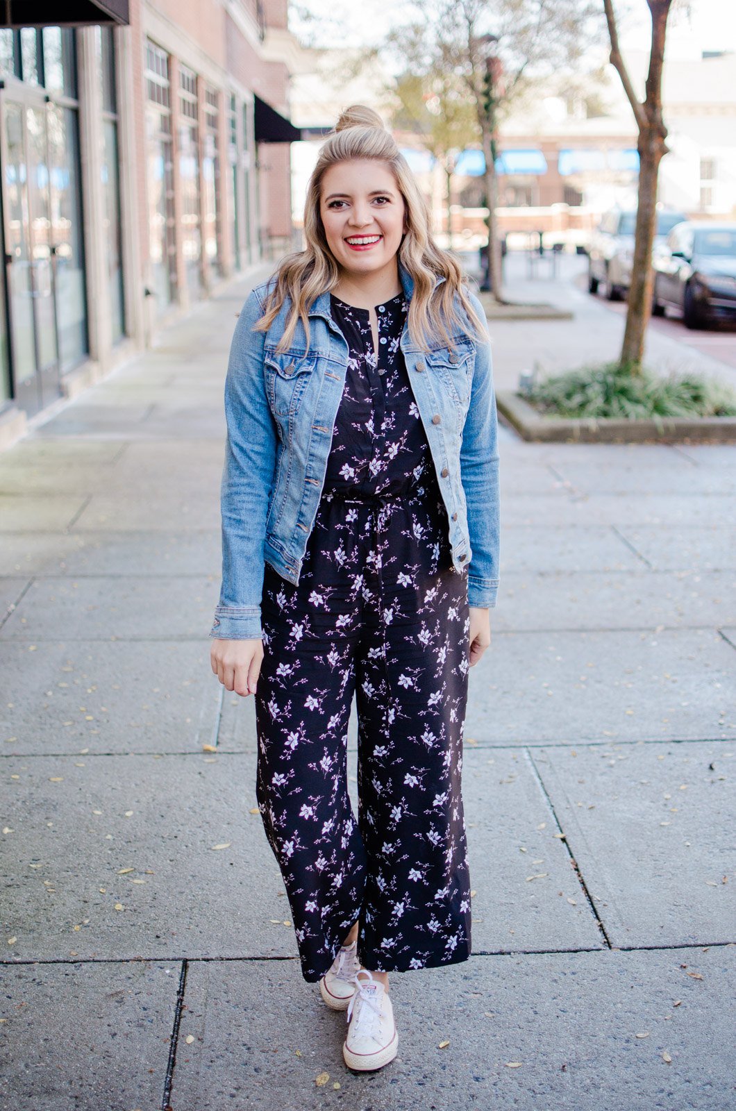 four jumpsuit outfits - weekend casual jumpsuit with a denim jacket and converse. Head to bylaurenm.com to see the other three ways to wear a jumpsuit!