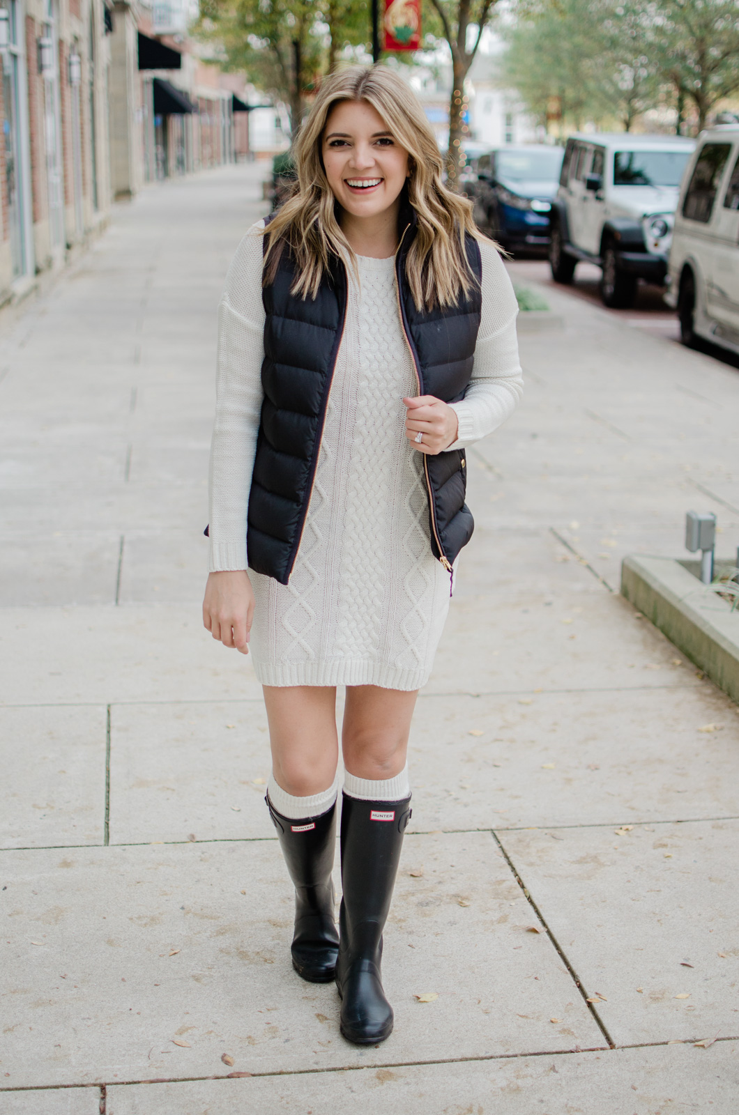 six puffer vest outfits - head to the blog to see all the ideas and get details of this cable knit sweater dress look! bylaurenm.com