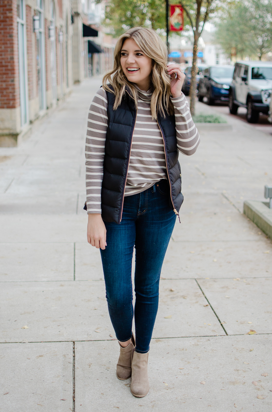 six puffer vest outfits - head to the blog to see all the ideas and get details of this stripe turtleneck look! bylaurenm.com