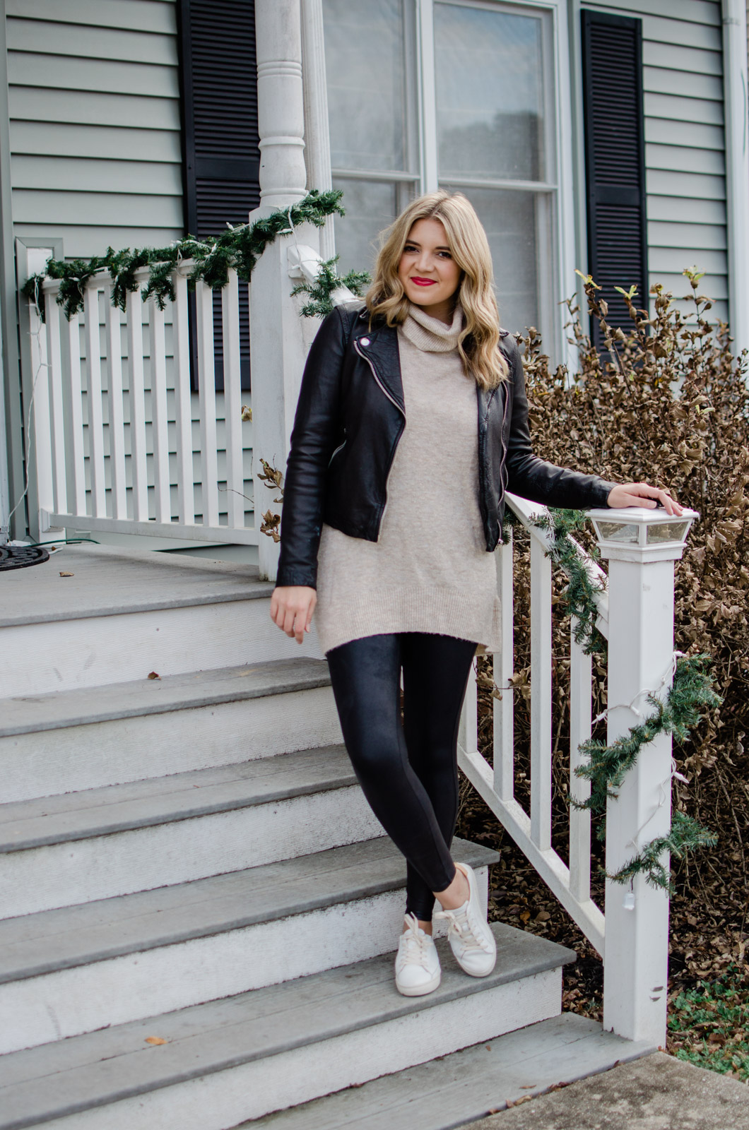 six leather jacket outfits - how to wear a leather jacket with a tunic sweater | See the additional five leather jacket outfit ideas at bylaurenm.com!