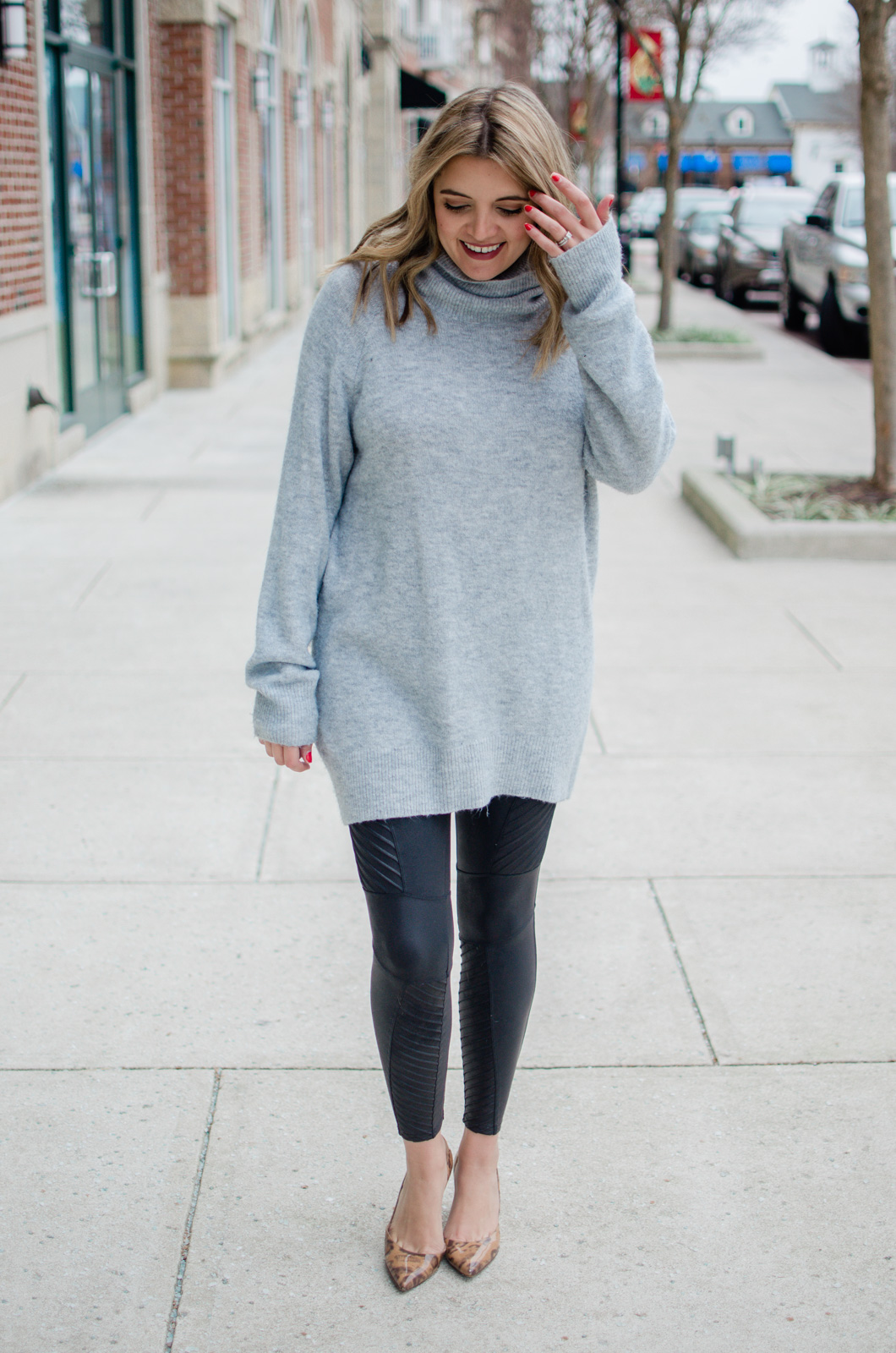 Affordable style blogger Lauren Dix shares four spanx faux leather moto leggings outfits for winter. From weekend casual to date night, these leggings outfits are perfect for so many occasions.