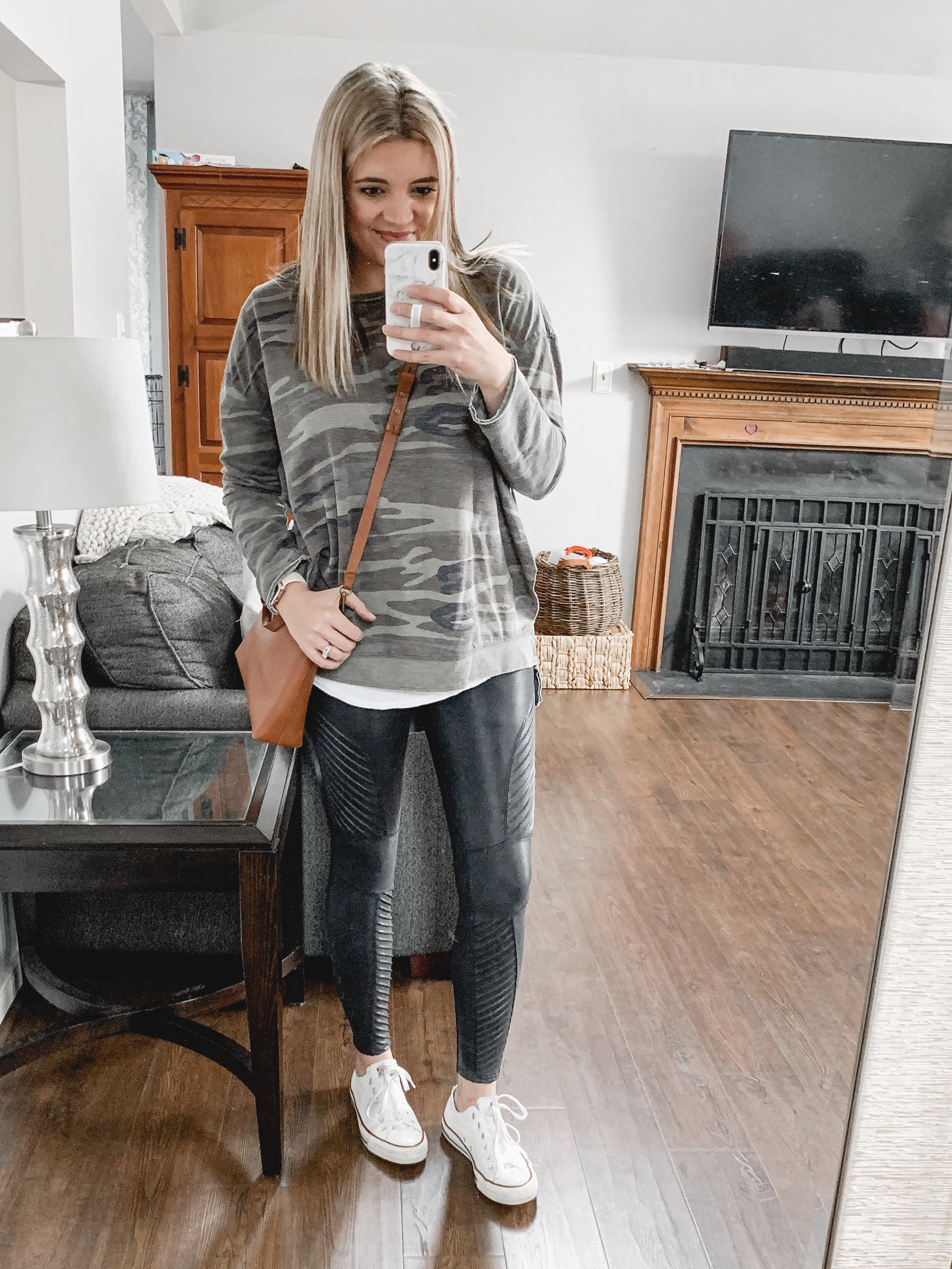 Affordable style blogger Lauren Dix shares her top Shopbop sale picks, including her favorite Spanx moto leggings!