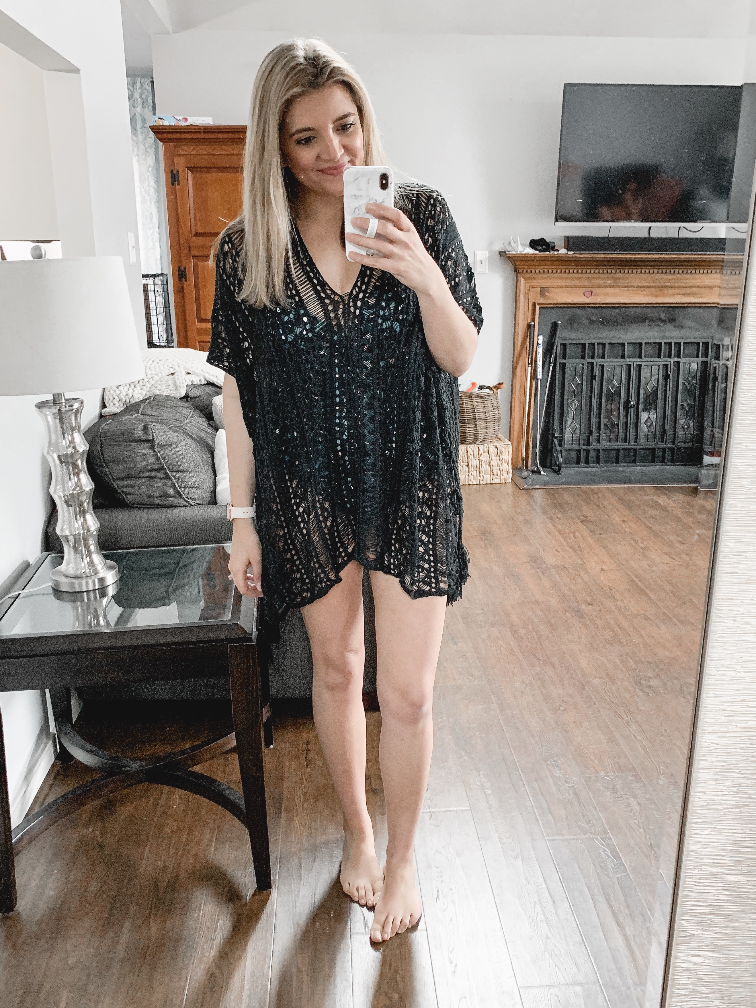 Affordable style blogger Lauren Dix shares over 25 of the best affordable one piece swimsuits and swimsuit cover ups!