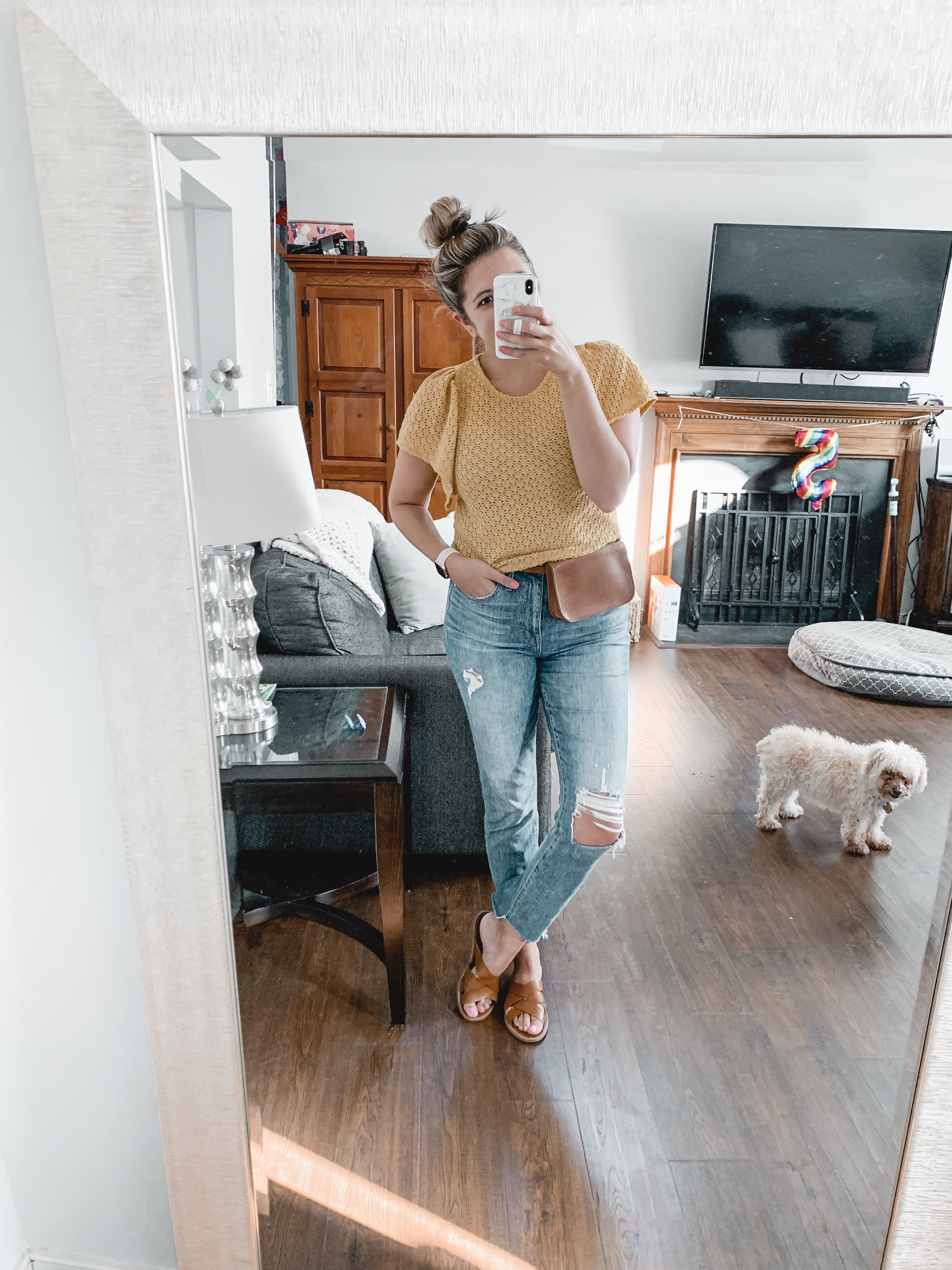 Lauren Dix shares the best Labor Day sales, including this Madewell outfit with yellow eyelet top, boyfriend jeans, and belt bag.