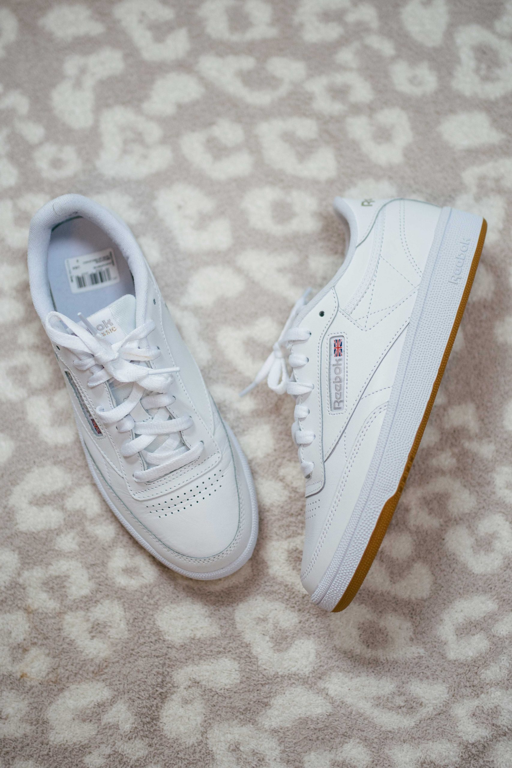 Virginia blogger, Lauren Dix, tries on 10 different pairs of white sneakers for the ultimate white sneaker review! The Reebok Club C 85 pictured here are included!