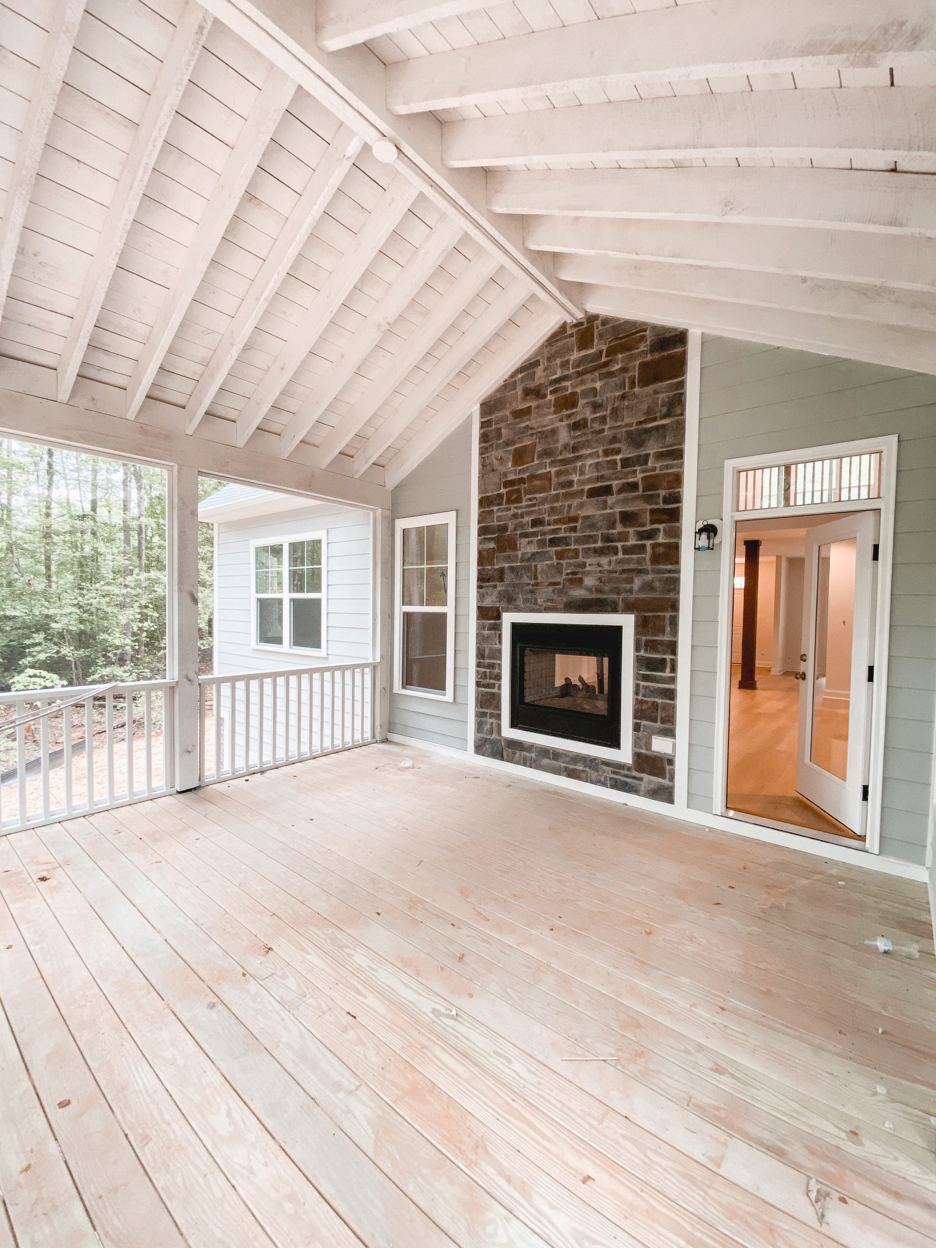 Virginia blogger, Lauren Dix, shares her screened in porch with stone fireplace in her outdoor furniture inspiration post!