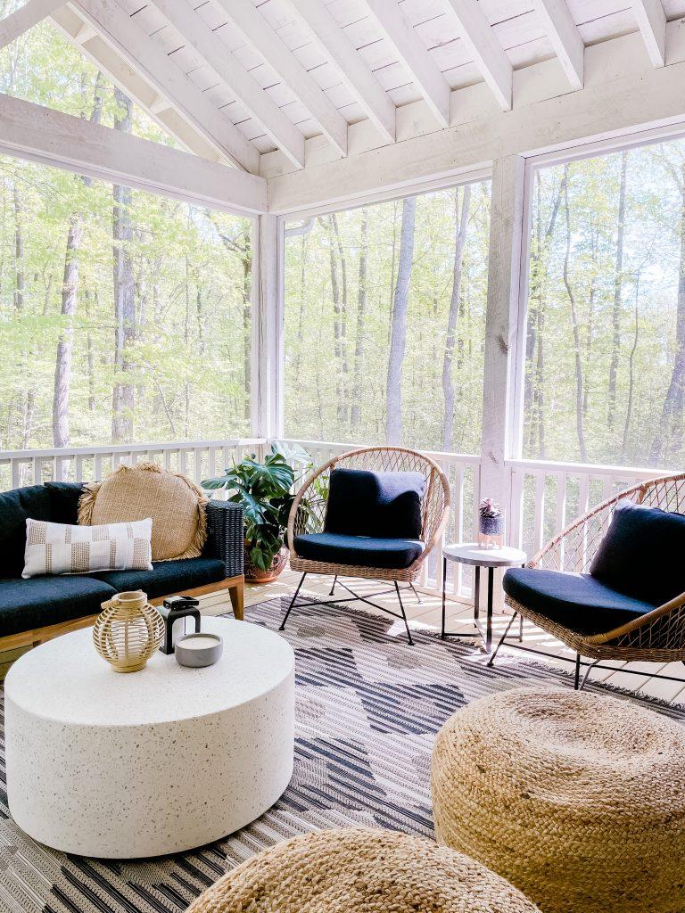 Virginia blogger, Lauren Dix, reveals her screened in porch with modern patio furniture. Modern boho outdoor furniture.