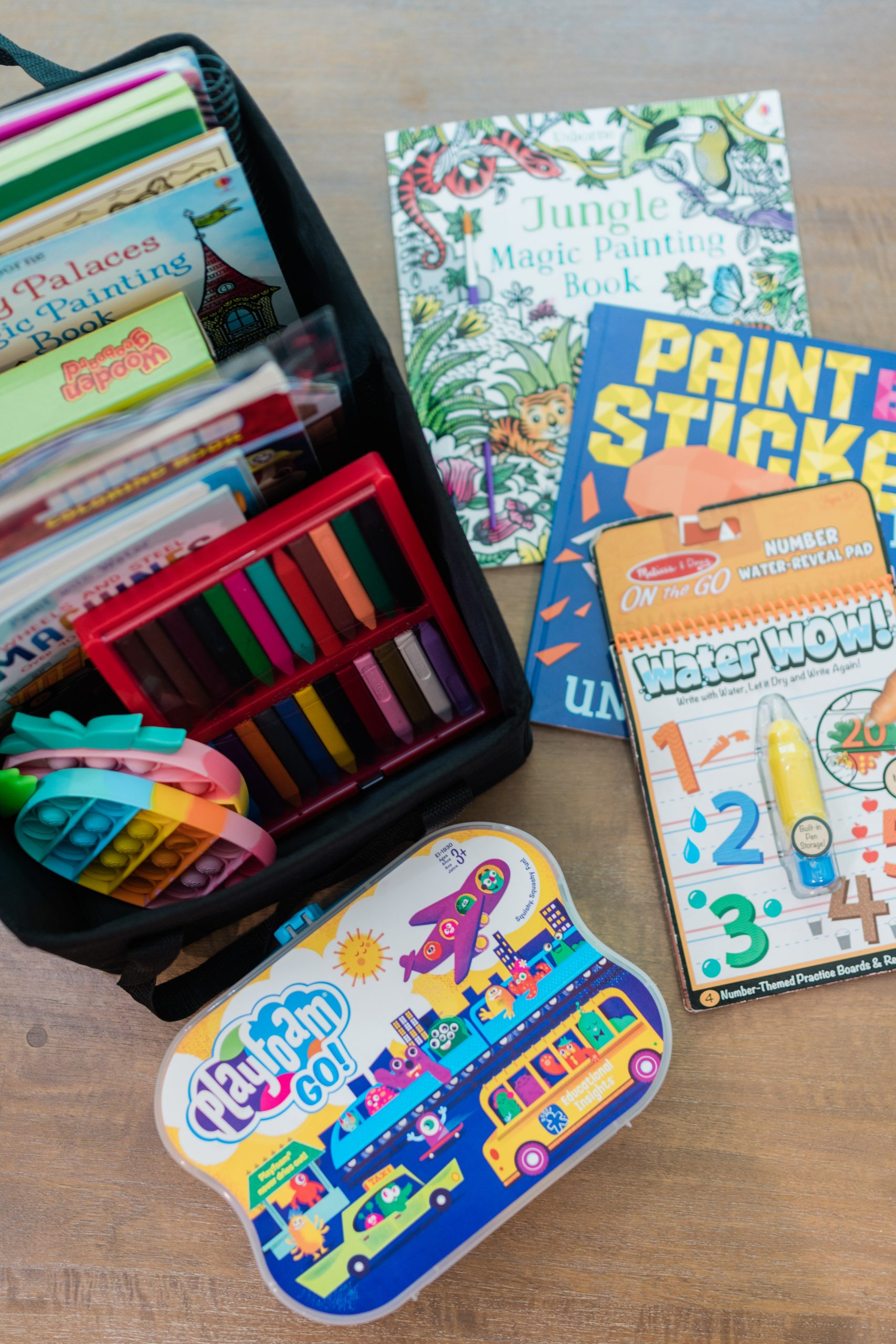 Virginia blogger, Lauren Dix, shares her backseat road trip activities kit for kids, including the perfect car organizer and activity books for the car!